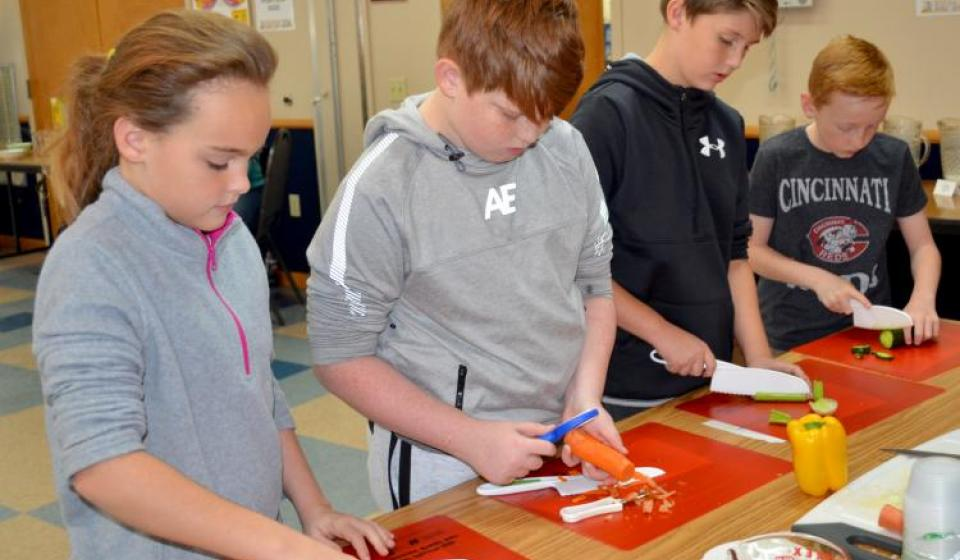 Owen County fifth-graders chop up vegetable appetizers during the Recipes for Life Program. Photo by Katie Pratt, UK agricultura